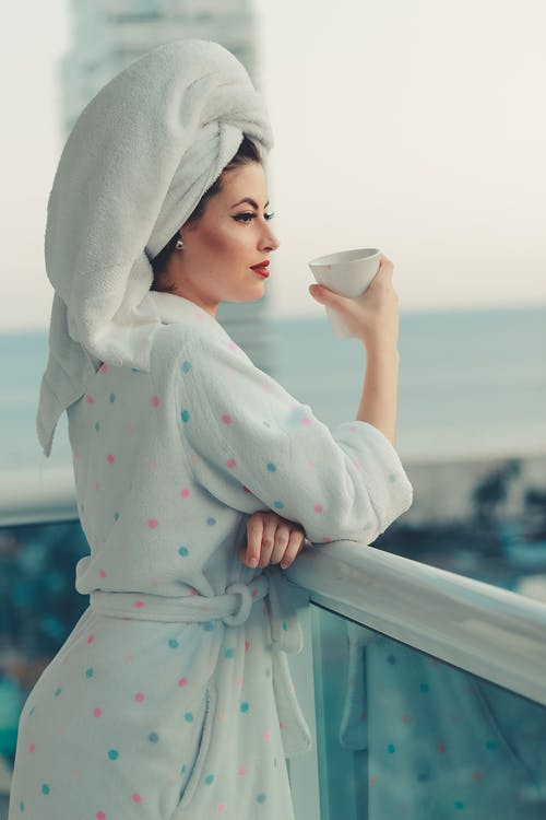 Photo of Woman Wearing Bathrobe