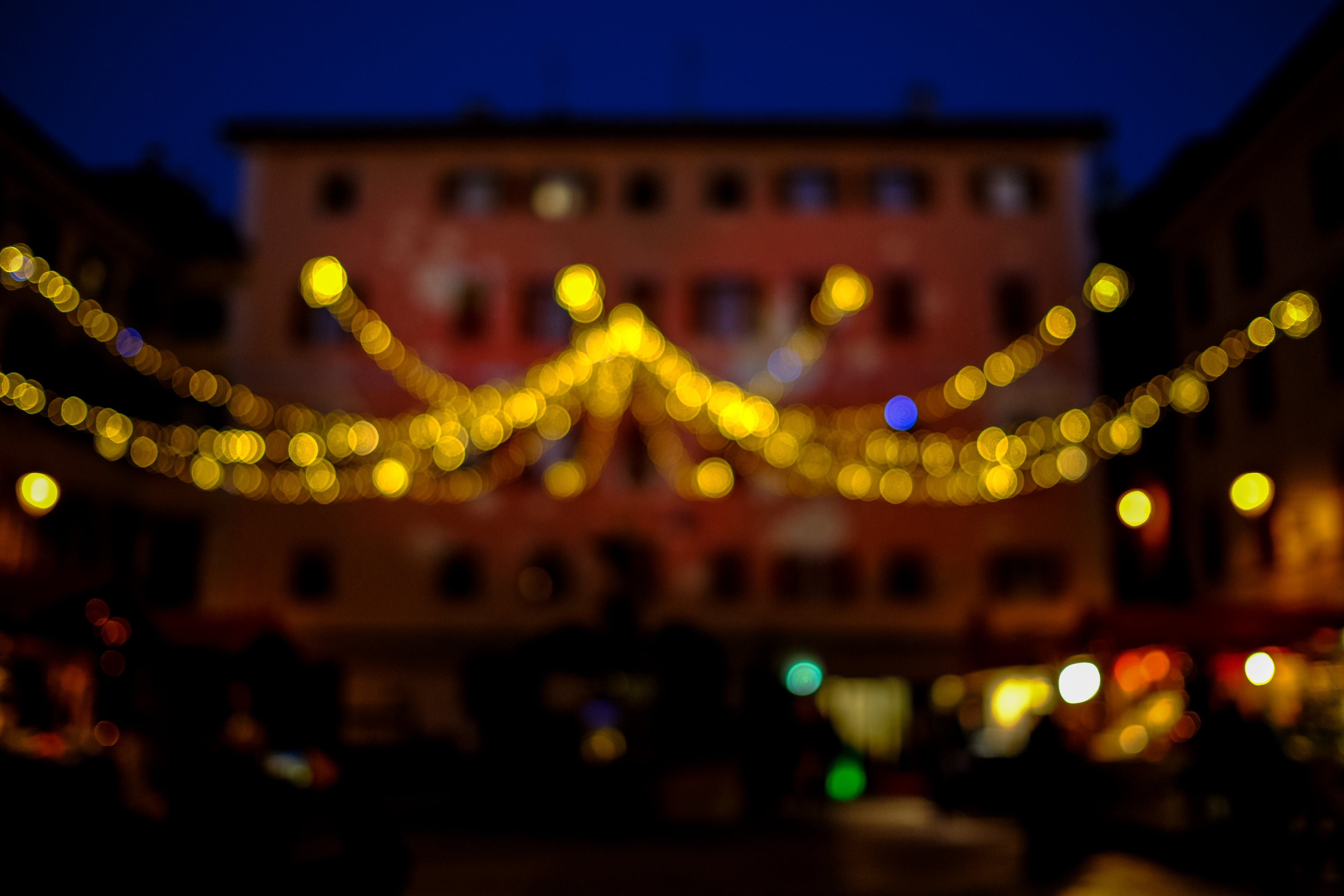 Yellow String Lights Outside Building during Dusk