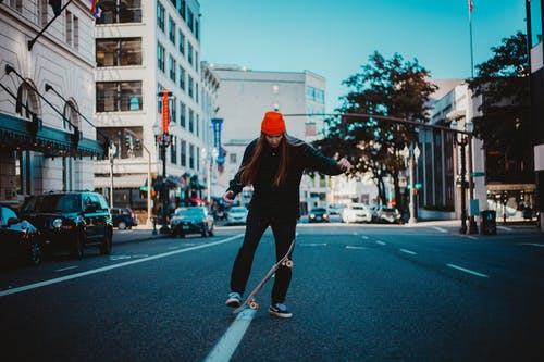 Woman Skateboard on Road