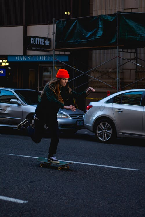 Unknown Person Riding on Skateboard Outdoors