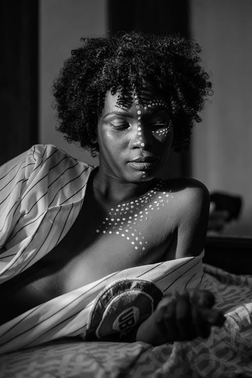 Grayscale Photography Of Woman On Bed
