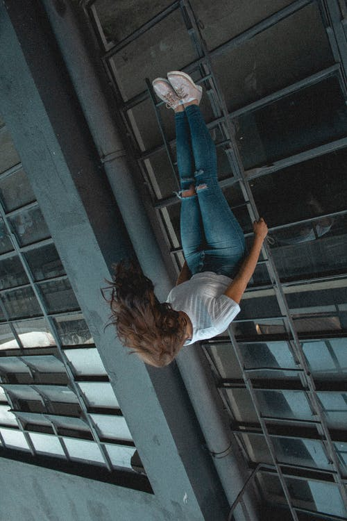 Photo of Woman in Upside Down Position