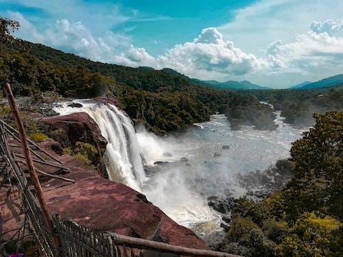 Безкоштовне стокове фото на тему «kerala, блакитне небо, вода, Водоспад»