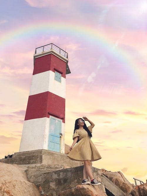 Gratis lagerfoto af fyrtårn, gul, gylden sol, kjole