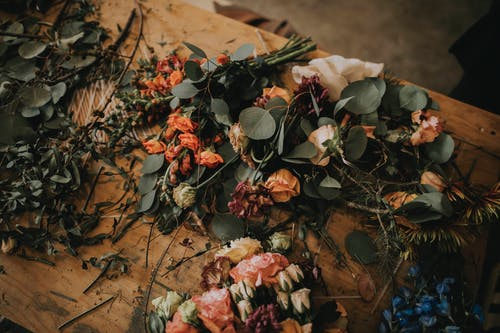 Photo of Flowers on Wooden Table