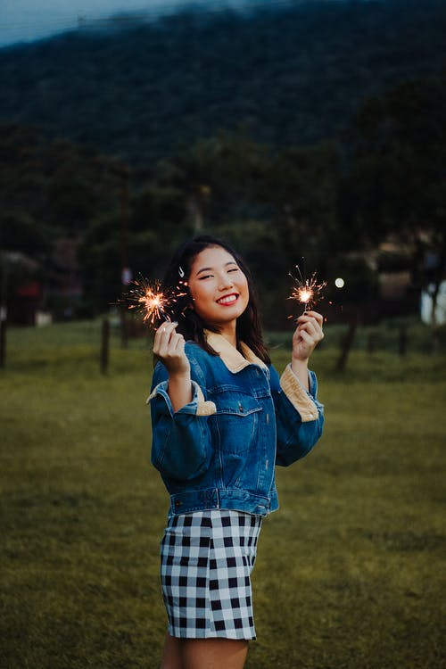 Photo of a Woman Holding Sparklers