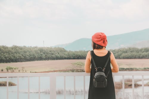 Photo of Woman Wearing Backpack