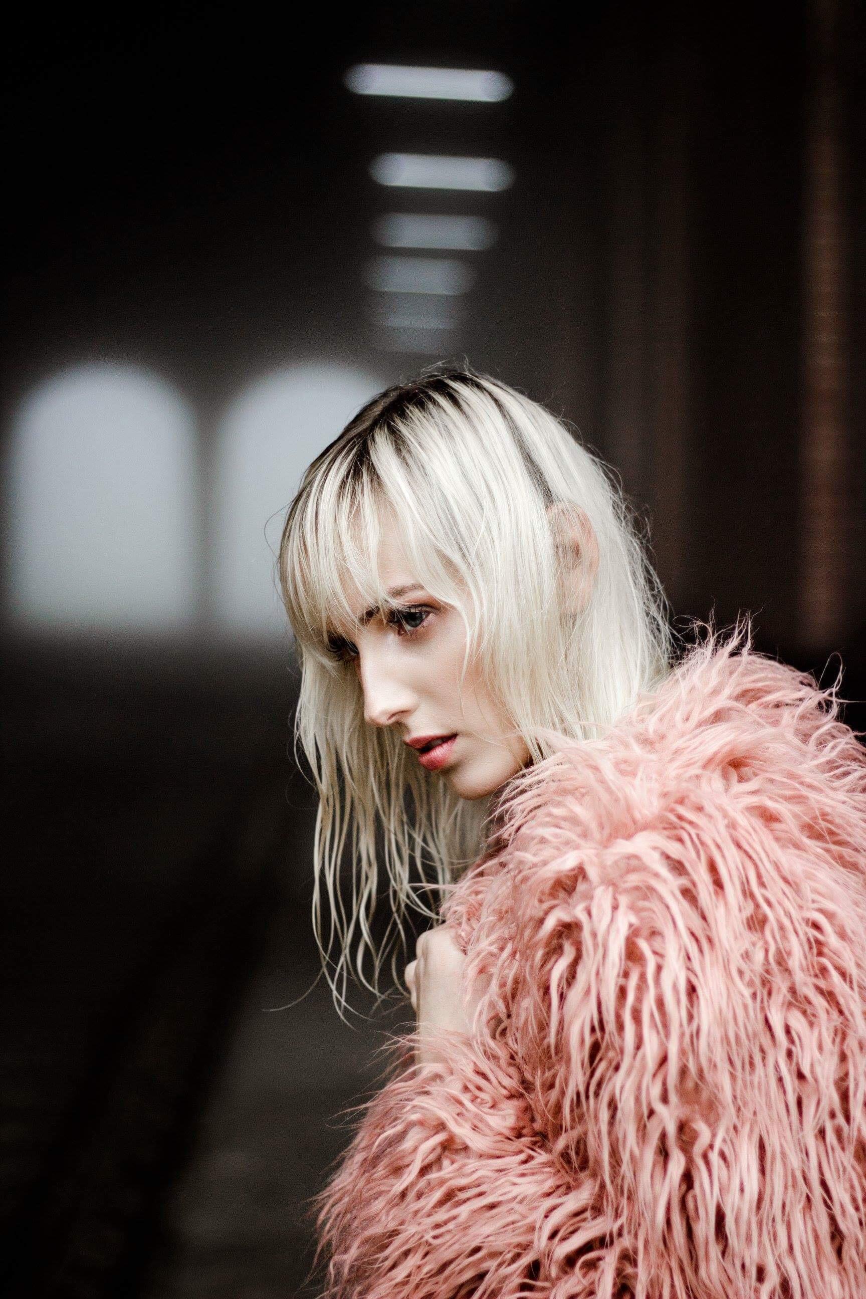 Woman Wearing Pink Fur Coat