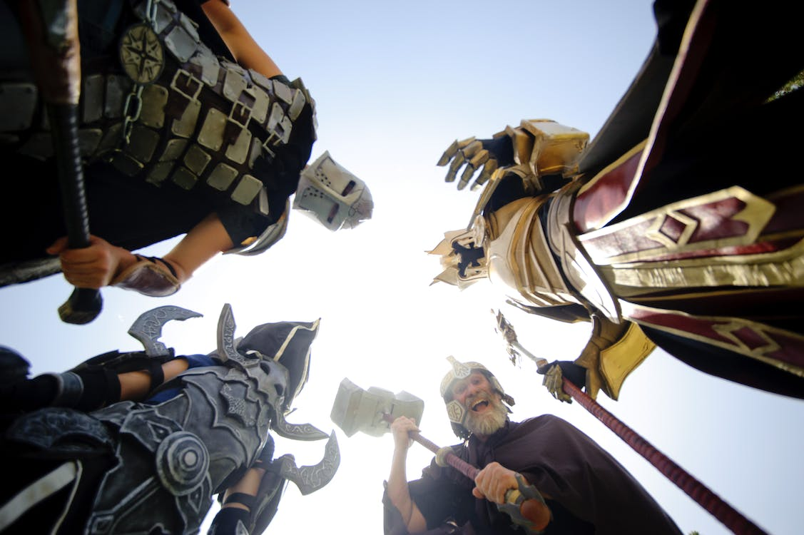 Low Angle View of Men Friends Against Sky
