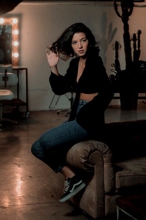 Photo of Woman Sitting on Sofa