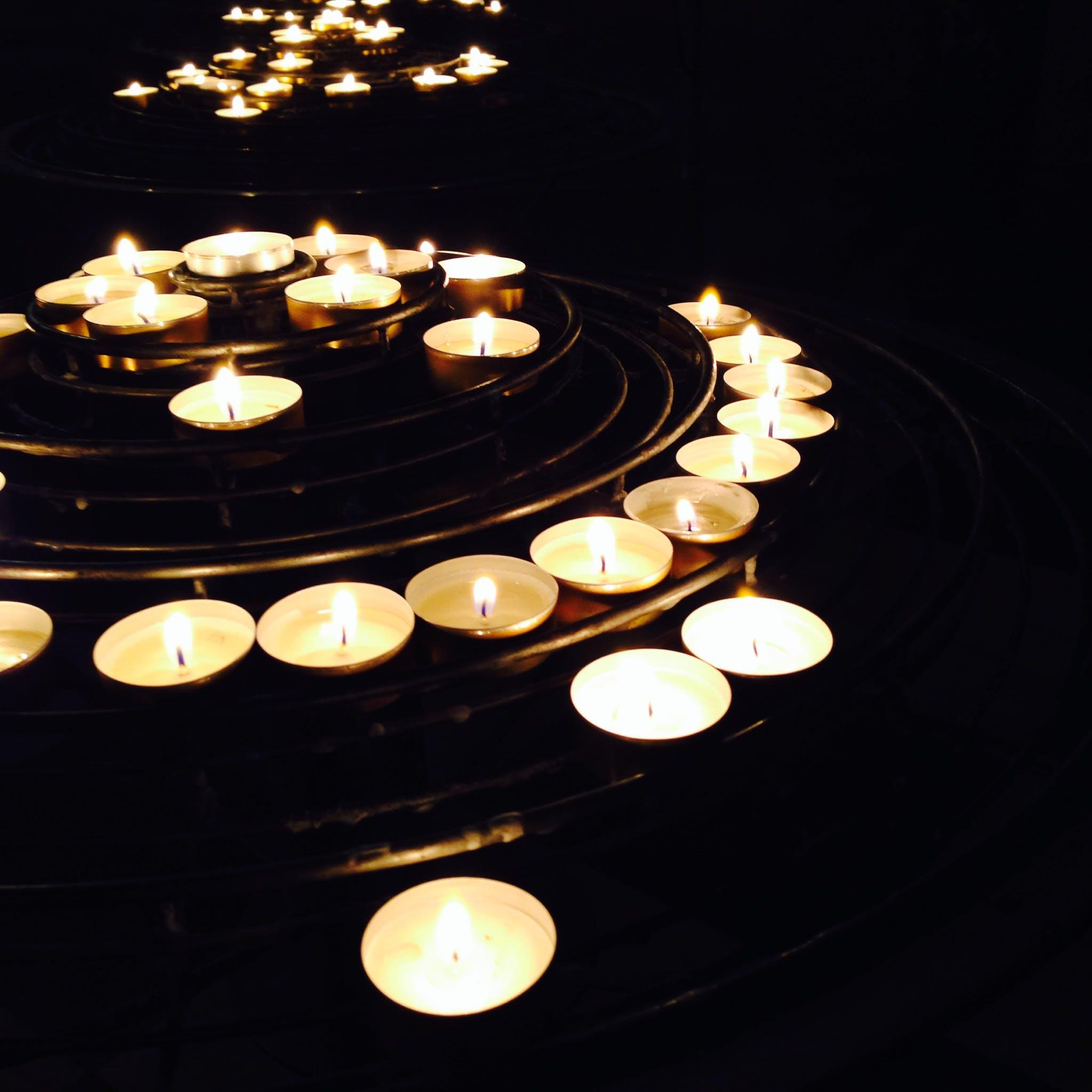 Illuminated Candles on Black Background