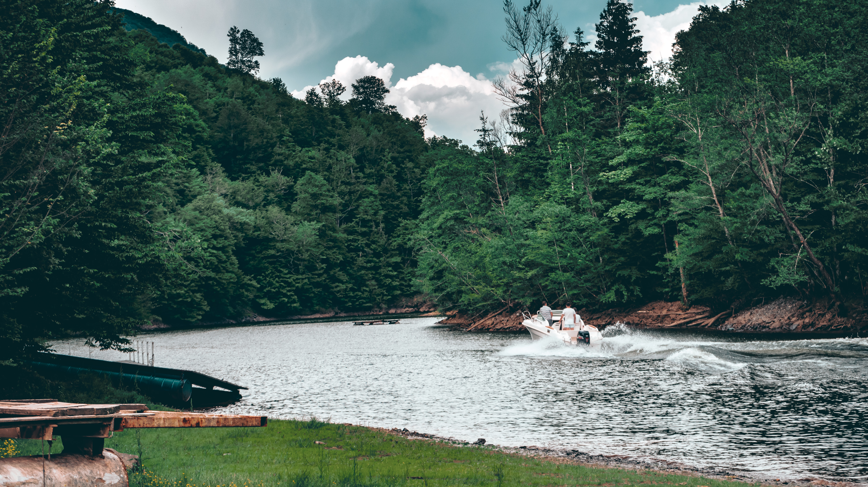 Photo of People Riding Speedboat