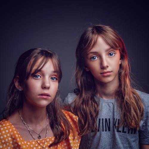 Twin Girls Standing Side By Side