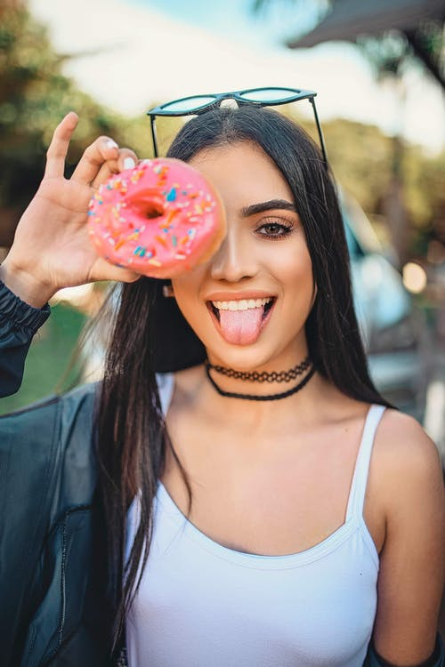 Woman In White Spaghetti Strap Top Holding Doughnut