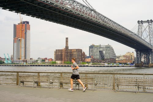 Free stock photo of bridge, east river, jogger, man