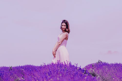 Photo of Woman Standing Near Lavender Field
