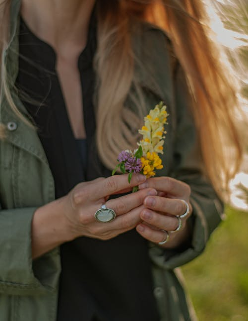 Close-Up Photo of Woman Holding Yellow Petaled Flower