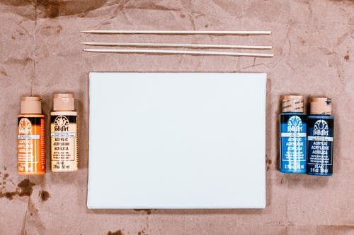 Flat Lay Photo of Blank Paper Near Art Materials