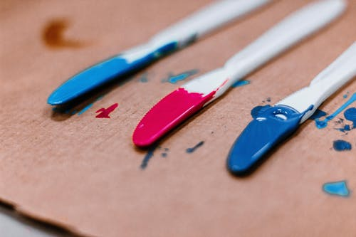 Close-Up Photo of Blue and Red Acrylic Paint