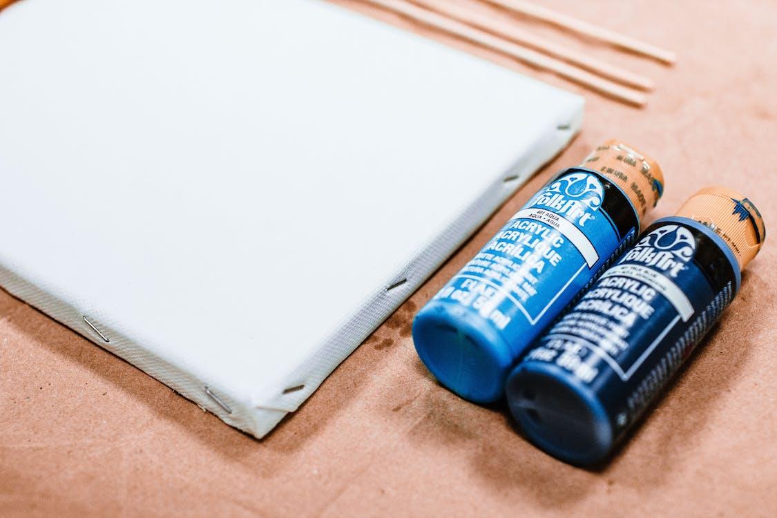 Close-Up Photo of Blue Acrylic Paint