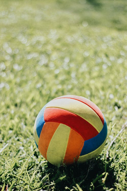 Selective Focus Photo of Multicolored Soccer Ball