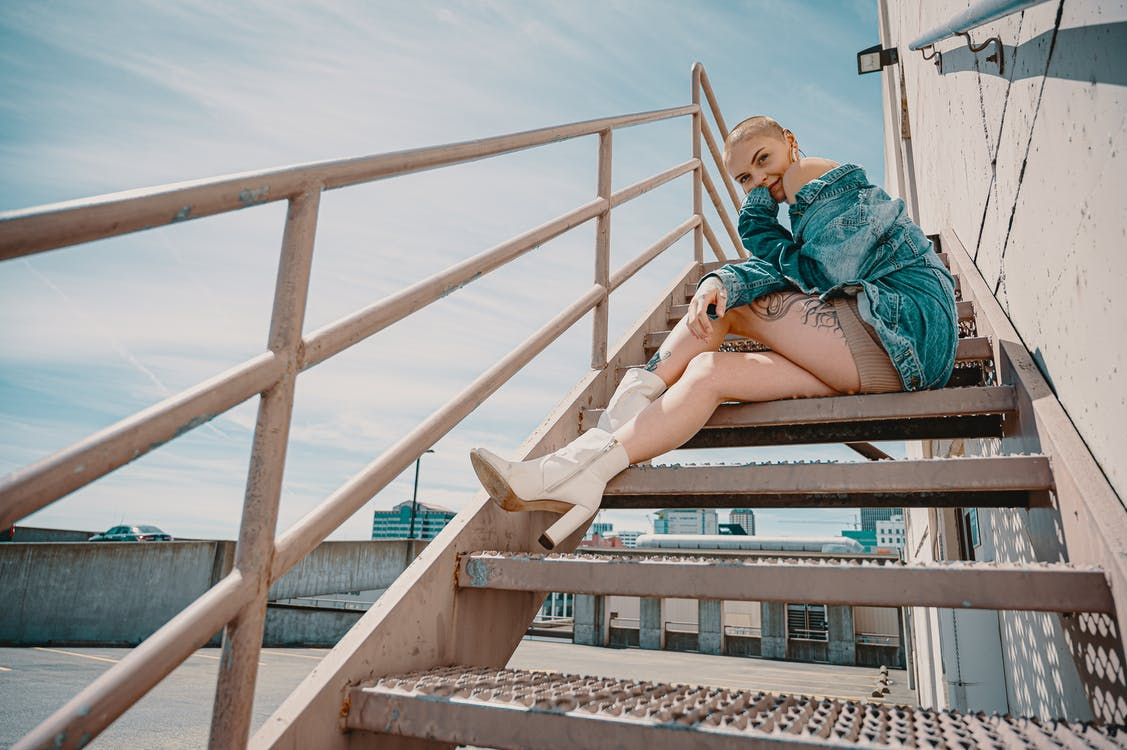 Photo of Woman Sitting on Staircase