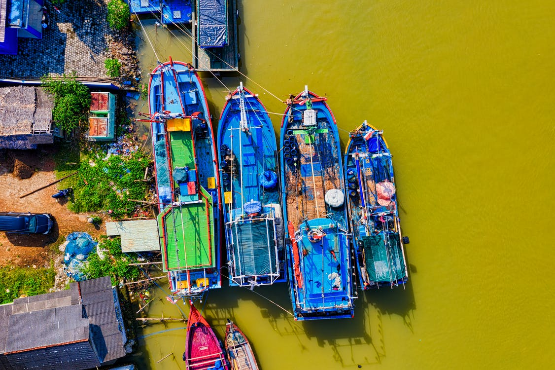 Lined Blue and Green Painted Boats