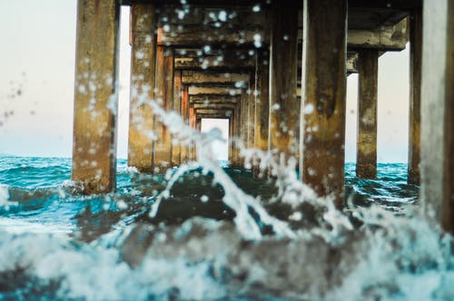 Sea Under Brown Wooden Dock
