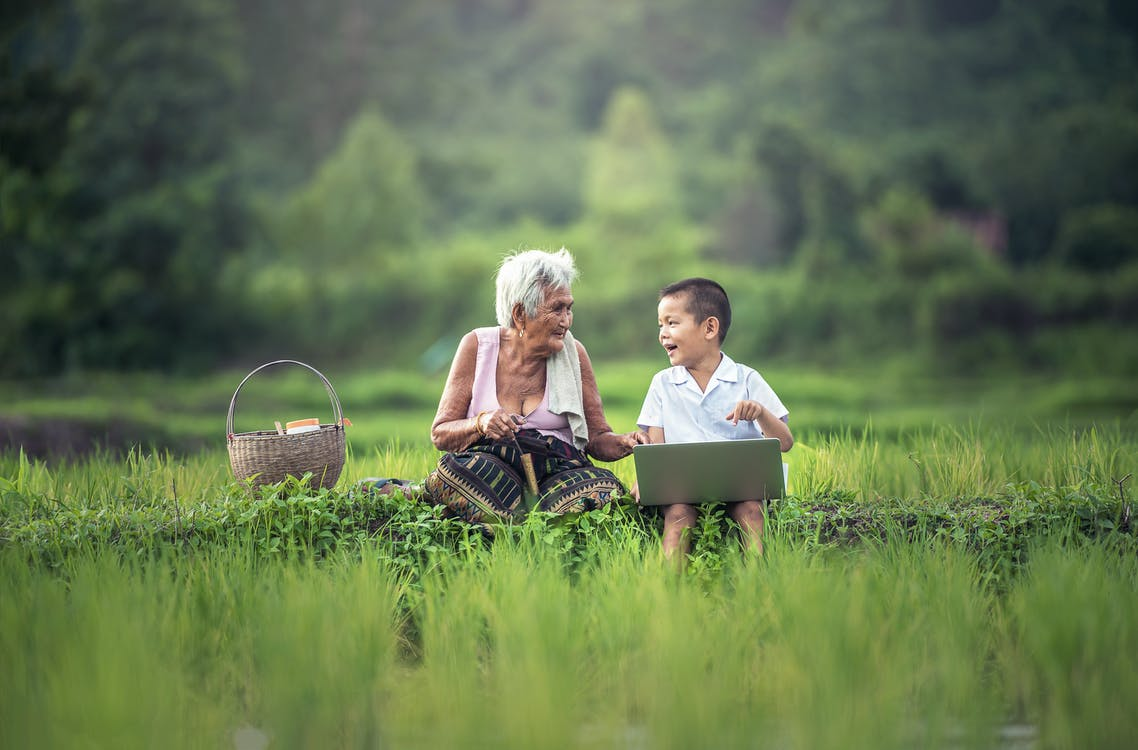 Old Woman Sitting Beside Her Grandson