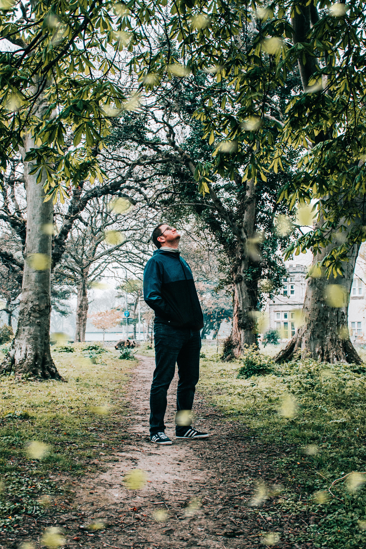 Photo of Man Standing Near Trees