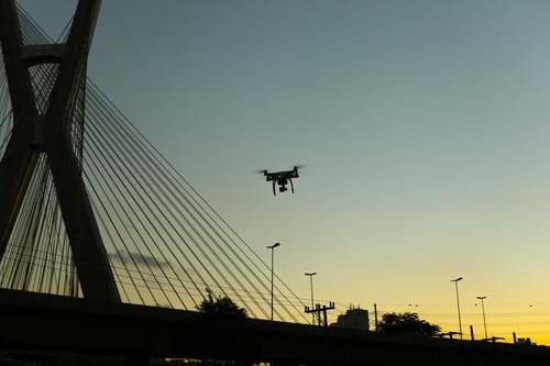 Silhouette Photo of Quadcopter