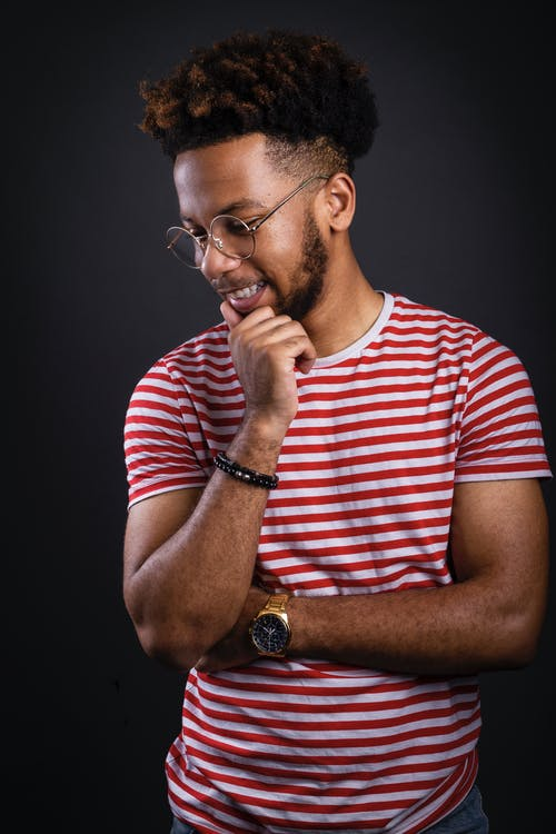 Photo of a Man wearing a White and Red striped Crew-neck T-shirt