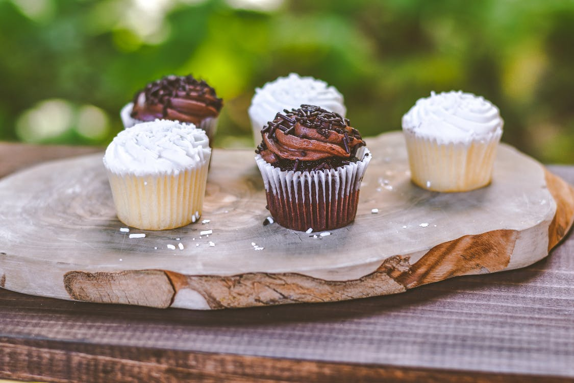 Photo of Five Cupcakes on Wooden Board