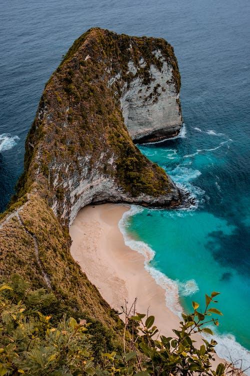 High Angle Photo of Seashore Near Rock Formation