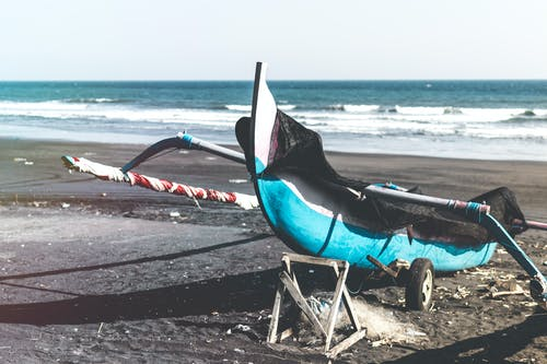 Photo of Fishing Boat on Shore During Daytime