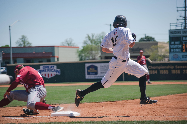 Photo of Man Running on Baseball Field