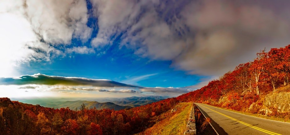 Scenic View of Mountain Road Against Cloudy Sky