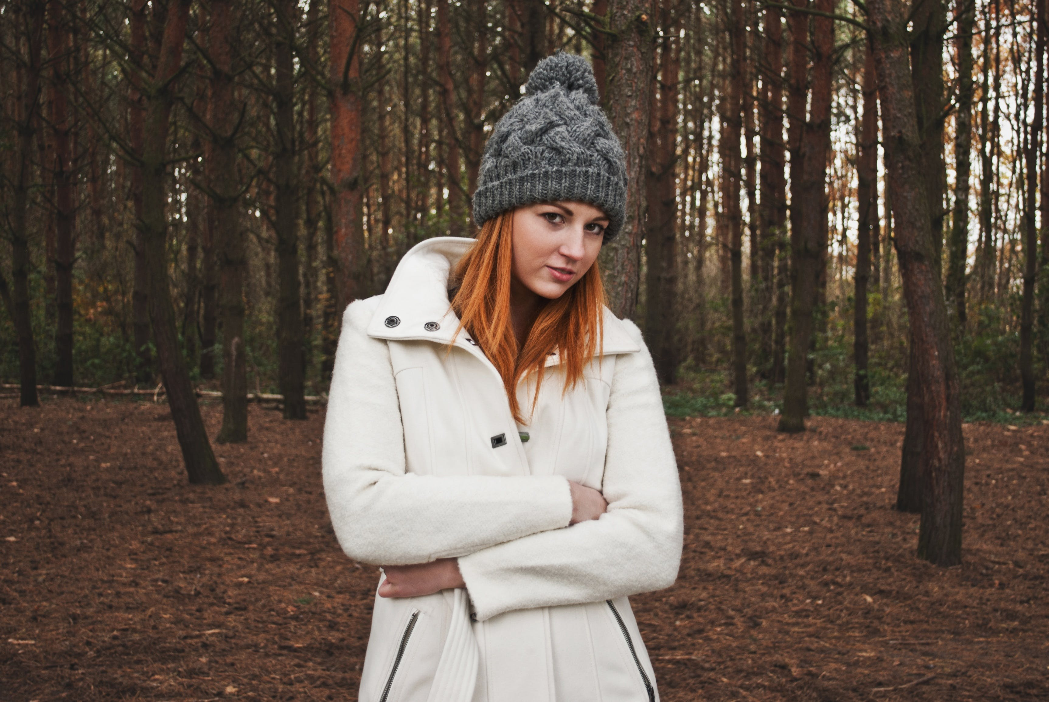Portrait of Smiling Woman Standing in Forest