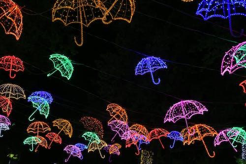 Photo of Neon Light Umbrellas