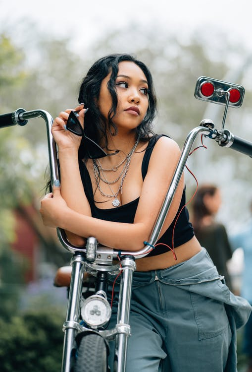 Photo of Woman Leaning on Chopper Motorcycle