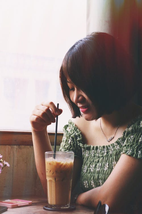 Photo of Woman Holding Drinking Straw