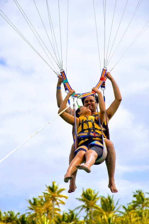 Photo of Couple Parasailing