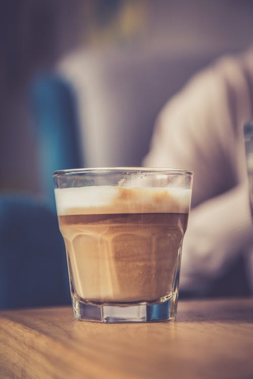Close-Up Photo of Glass Cup With Coffee on Table