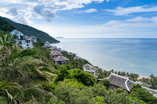 Aerial Photography of Villas Near Seashore