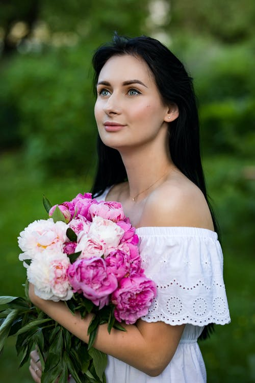 Photo of Woman Wearing Off Shoulder White Dress