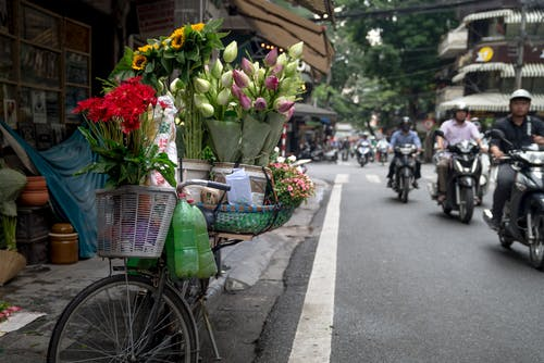 Selective Focus Photo of Flowers on Bicycle