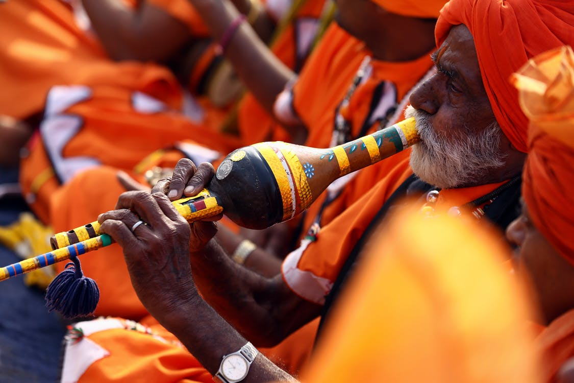 Close-Up Photo of Man Playing Wind Instrument
