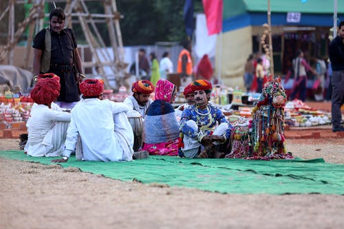 People Sitting on Green Textile