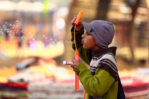 Photo of Boy Blowing Bubbles