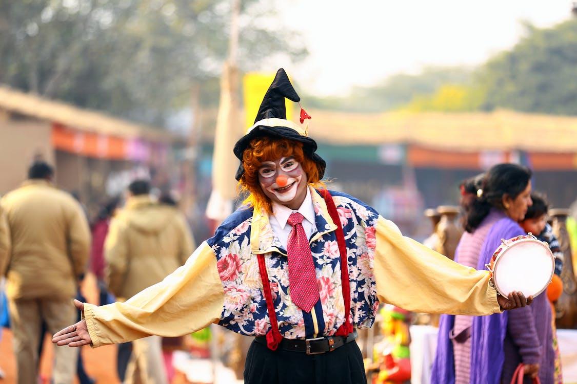 Photo of Clown Holding Tambourine